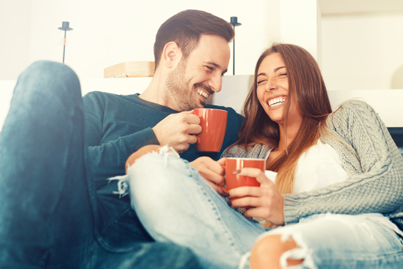 Cheerful young couple in the morning at home - What Does The Aries Man Want In A Relationship