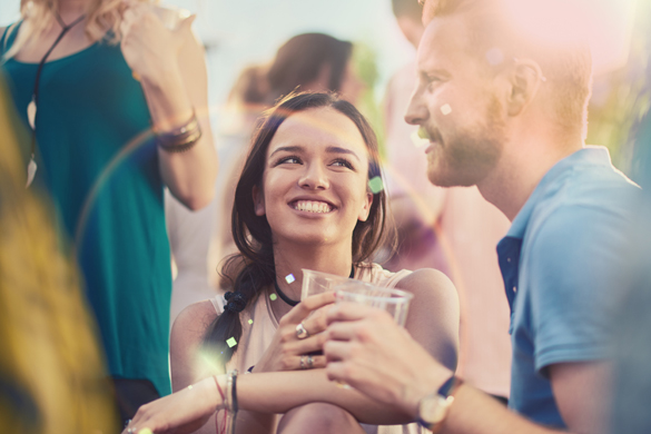 Couple flirting at the party - How To Effectively Flirt With An Aries Man