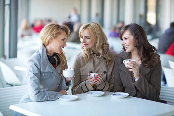 Group of young ladies drinking coffee - What an Aries Man Really Wants In a Woman