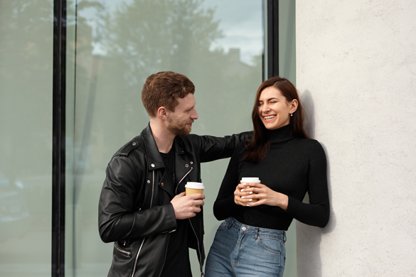 Happy young couple in love flirting on a first date - How To Effectively Flirt With An Aries Man