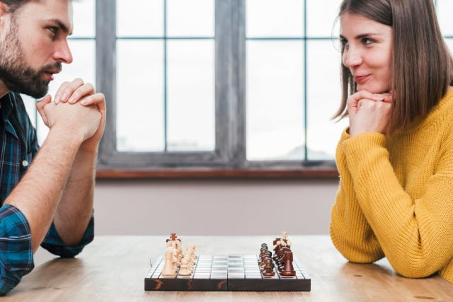 Couple Playing A Competitive Game - Date Night Ideas With An Aries Man